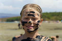 Girl with dirty face Stock Images