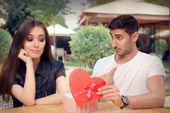 Girl Disappointed on Her Valentine Gift From Boyfriend Royalty Free Stock Photography