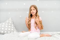 Girl disappointed with long curly hair grey background. Things you shouldnt do at night if you want healthier hair. How. To style hair before go to bed. Hair stock photo