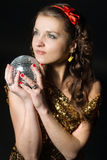 girl with disco ball Stock Photo
