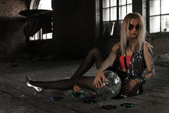 A girl with disco ball at abandoned house royalty free stock photography