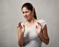 Girl disgusted face expression. Young woman disgusted squeamishness over gray wall background Royalty Free Stock Photo