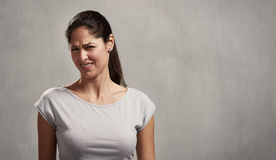 Girl disgusted face expression Stock Image
