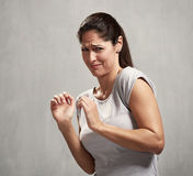 Girl disgusted face expression. Young woman disgusted squeamishness over gray wall background Royalty Free Stock Photos