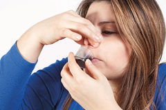 Girl and disgusting medicine Stock Images