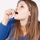 Girl and disgusting medicine Stock Photo