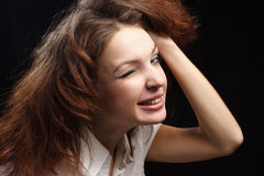 Girl dishevelled hair and give a wink black Stock Photo