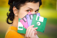 Girl with diskettes Stock Photo
