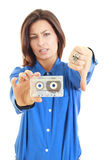 Girl dislikes old audio cassette Royalty Free Stock Image