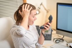 Girl dispatcher shouts working with the phone. In the call center, angry. evil.  royalty free stock photography