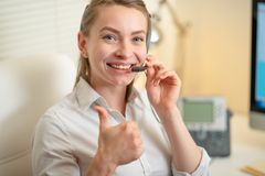 Girl dispatcher shouts working with the phone. In the call center, smile and positive. / stock images