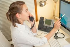 Girl dispatcher works with the phone. In the call center royalty free stock photography