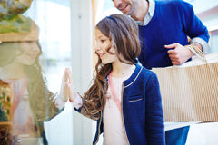 Girl by display-window Royalty Free Stock Photography