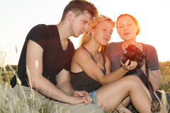 Girl displaying images on her camera to brother stock photos