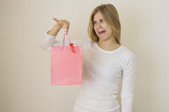 Girl dissapointed with her purchase Royalty Free Stock Photos