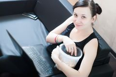 Girl distracted from watching series, stock images