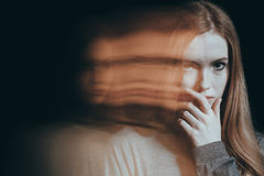 Girl with a distrustful look royalty free stock images