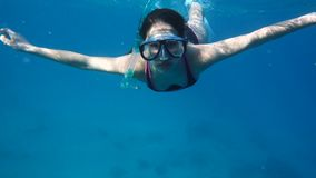 Girl dive in the Red sea with underwater mask. Slow motion stock footage