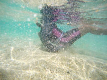 Girl dive underwater with blue sea. Girl dive underwater with blue sea royalty free stock photos
