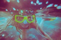 Girl dive underwater stock photos