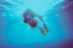 Girl dive underwater royalty free stock photography