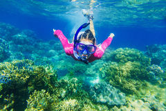 Girl dives in a tropical sea Stock Photo