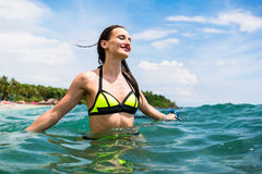 Girl with diving goggles in sea having summer vacation Royalty Free Stock Photography