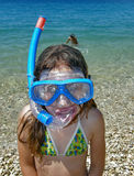 Girl with diving mask. Portrait of a young child - girl - snorkel s with diving mask on blue green sea in Croatia Dalmatia at sunny day. Vertical color photo Stock Photography