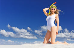 Girl with diving mask on the beach Royalty Free Stock Images