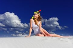 Girl with diving mask on the beach Royalty Free Stock Photography