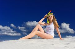 Girl with diving mask on the beach Royalty Free Stock Photos