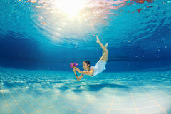 Girl diving in the pool Royalty Free Stock Image