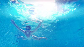 Girl diving in the pool. Young woman swim and dive in the beautiful swimming pool, underwater video clip stock video footage
