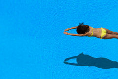 Girl diving in the swimming pool. Top view of a girl diving in the swimming pool Royalty Free Stock Image