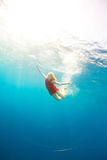 Girl diving under the sea Royalty Free Stock Photo