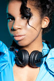 Girl DJ with headphones Stock Image