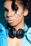 Girl DJ with headphones Stock Image