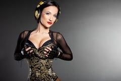 Girl DJ listens music Royalty Free Stock Images