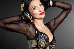 Girl DJ listens music Stock Image