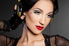 Girl DJ listens music Royalty Free Stock Photo