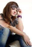 Girl DJ sitting with headphones on her neck Royalty Free Stock Photo