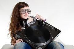 Girl DJ sitting with turntable in her arms Stock Photography
