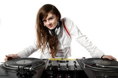 Girl DJ at the turntables. Attractive young chick playing music from vinyl records (isolated on white background Royalty Free Stock Images