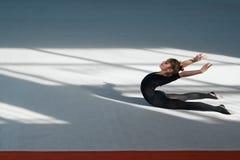 Girl do backfold rhythmic gymnastics Royalty Free Stock Photos