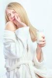 Girl do not like to drink milk. Blond hair girl do not like taste of milk Royalty Free Stock Photo
