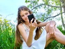 Girl do selfie snapshot blossoming tree Stock Photography