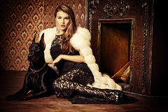 Girl with doberman royalty free stock photography