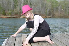 Girl on the dock 2 Royalty Free Stock Photos