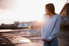 Girl in a sweater near the sea. Girl on the dock in a sweater near the sea Stock Photography