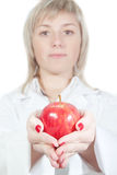 Girl doctor with an apple. royalty free stock images